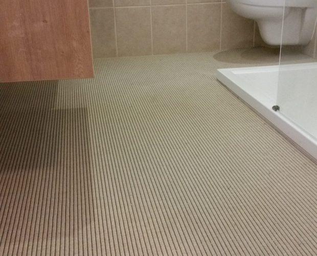 badkamer tapijt beige