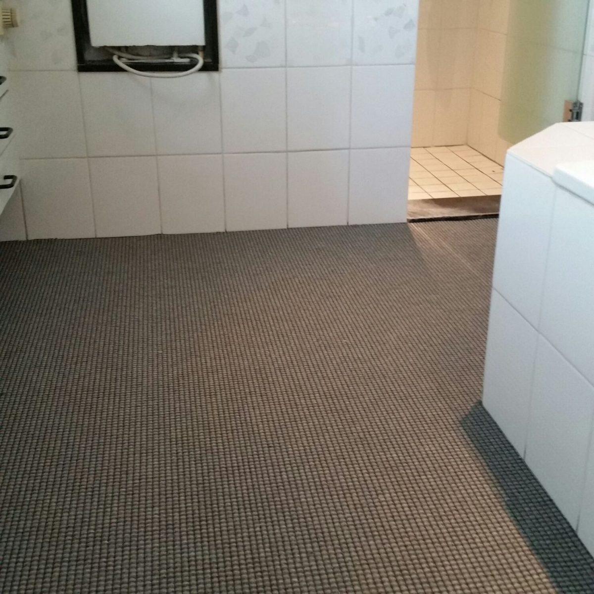 Badkamer tapijt zand